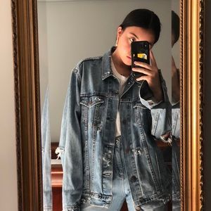 Vintage and distressed Levi's denim jacket